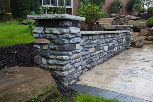 Decorative Stone Wall Along Concrete Patio