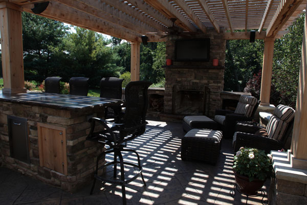 Outdoor Living Room and Kitchen Designed with Fireplace