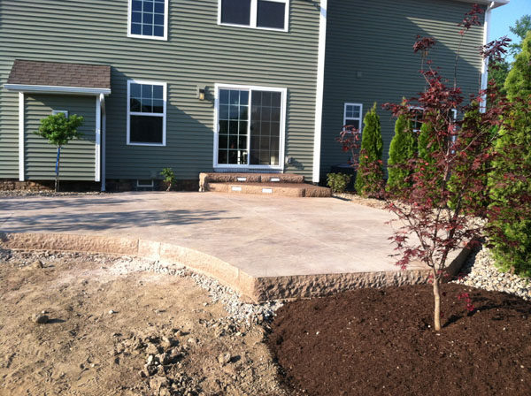 Rock Face Elevated Concrete Patio